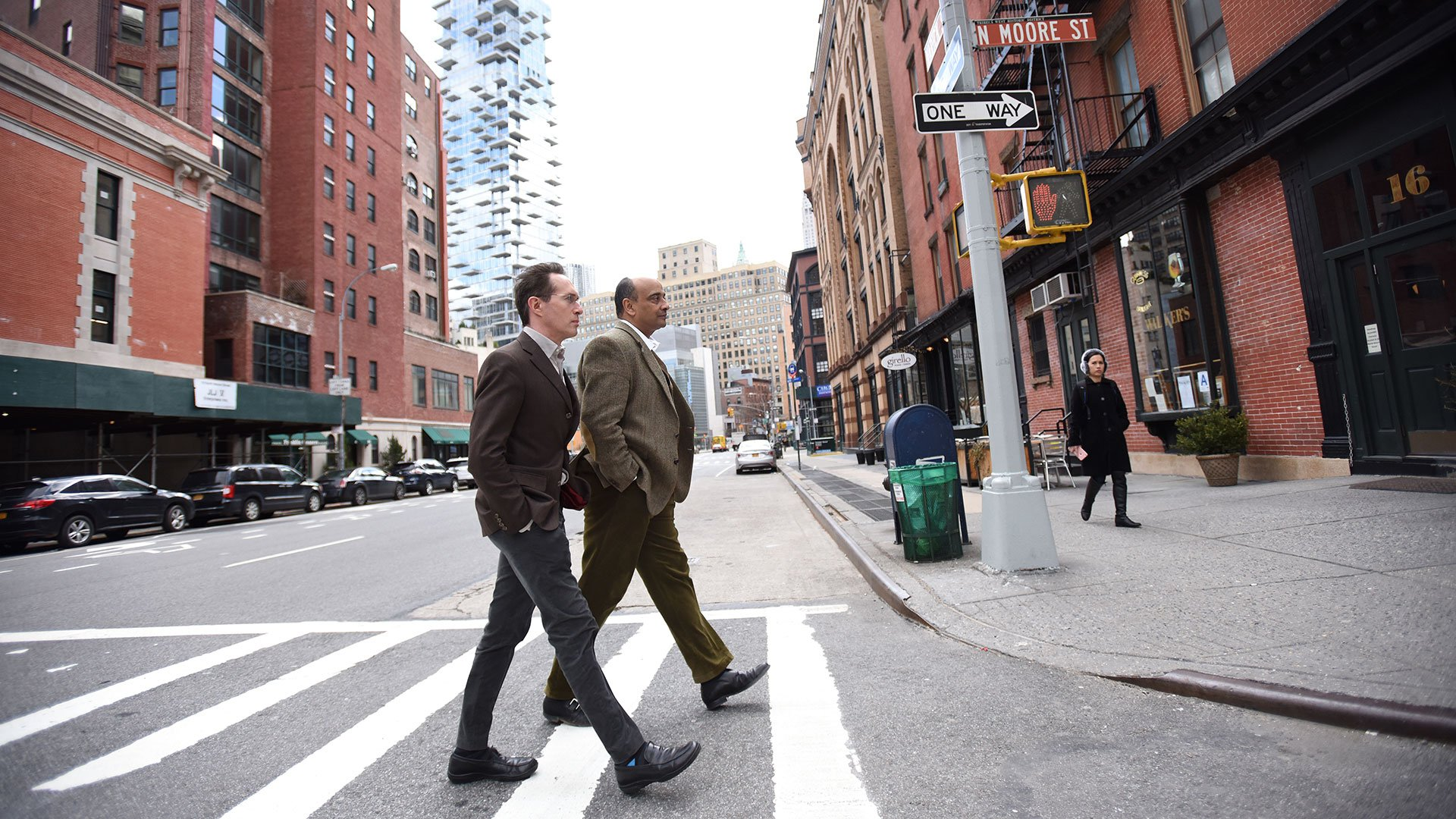 Kwame Anthony Appiah walking across the street