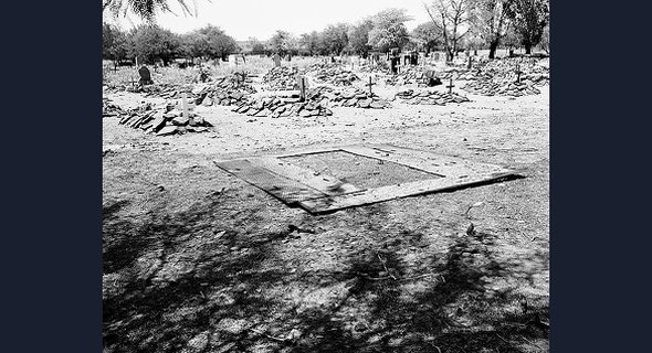 "TEMPLATE FOR DIGGING GRAVES, POMFRET: The abandoned mining town of Pomfret in the far north of South Africa was converted into a military base. For the veterans whose paths ended here, death in Pomfret was ""the final displacement."""